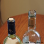 The Tops of a Corked bottle and a Screw Cap bottle