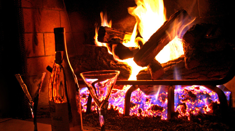 Wine in front of a Fireplace